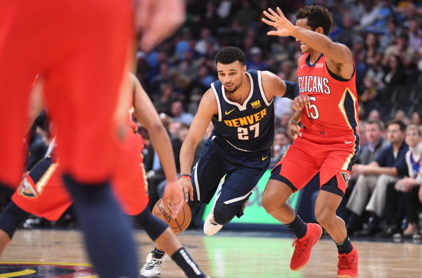 Jamal Murray #27 of the Denver Nuggets drives to the basket against Frank Jackson #15 of the New Orleans Pelicans (Photo by Justin Tafoya/Getty Images)