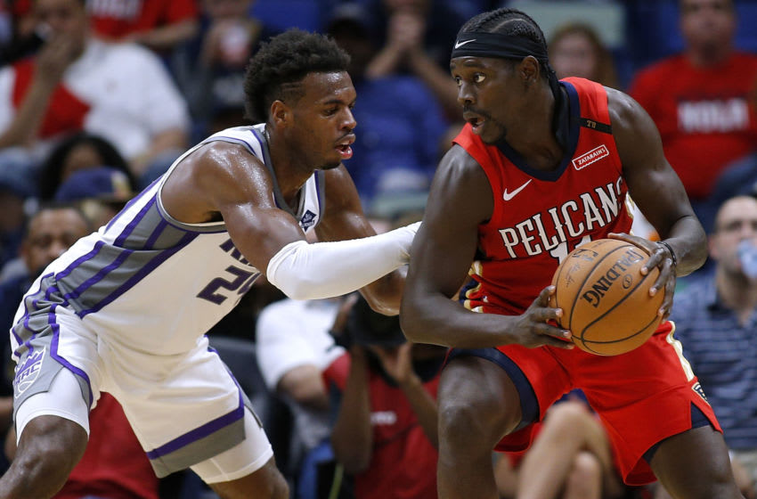 Jrue Holiday #11 of the New Orleans Pelicans drives against Buddy Hield chman/Getty Images)