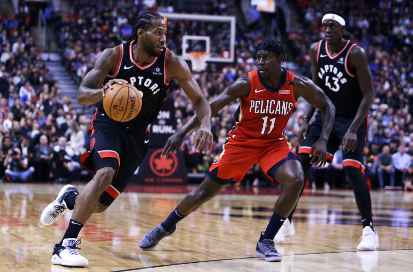 TORONTO, ON - NOVEMBER 12: Kawhi Leonard #2 of the Toronto Raptors dribbles the ball as Jrue Holiday #11 of the New Orleans Pelicans defends during the second half of an NBA game at Scotiabank Arena on November 12, 2018 in Toronto, Canada. NOTE TO USER: User expressly acknowledges and agrees that, by downloading and or using this photograph, User is consenting to the terms and conditions of the Getty Images License Agreement. (Photo by Vaughn Ridley/Getty Images)
