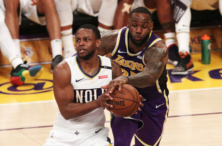 LeBron James #23 of the Los Angeles Lakers competes for the ball against Darius Miller #21 of the New Orleans Pelicans (Photo by Yong Teck Lim/Getty Images)