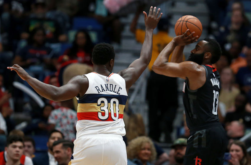 NEW ORLEANS, LOUISIANA - MARCH 24: James Harden #13 of the Houston Rockets shoots over Julius Randle #30 of the New Orleans Pelicans during the first half at the Smoothie King Center on March 24, 2019 in New Orleans, Louisiana. NOTE TO USER: User expressly acknowledges and agrees that, by downloading and or using this photograph, User is consenting to the terms and conditions of the Getty Images License Agreement. (Photo by Sean Gardner/Getty Images)
