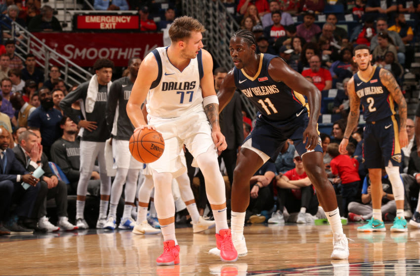 NEW ORLEANS, LA -OCTOBER 25: Luka Doncic #77 of the Dallas Mavericks handles the ball against the New Orleans Pelicans on October 25, 2019 at the Smoothie King Center in New Orleans, Louisiana. NOTE TO USER: User expressly acknowledges and agrees that, by downloading and or using this Photograph, user is consenting to the terms and conditions of the Getty Images License Agreement. Mandatory Copyright Notice: Copyright 2019 NBAE (Photo by Layne Murdoch Jr./NBAE via Getty Images)