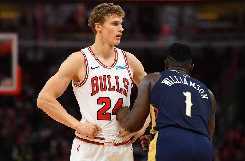 CHICAGO, ILLINOIS - OCTOBER 09: Lauri Markkanen #24 of the Chicago Bulls is defended by Zion Williamson #1 of the New Orleans Pelicans (Photo by Stacy Revere/Getty Images)