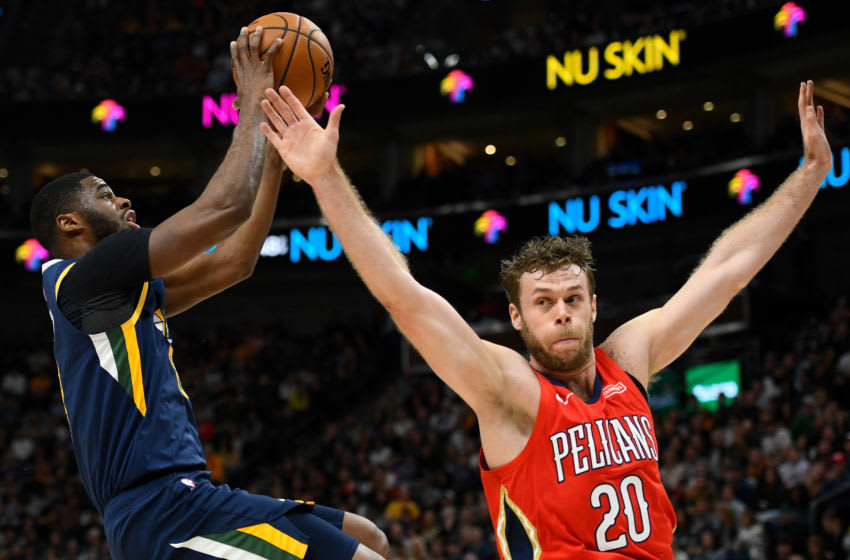 Emmanuel Mudiay #8 of the Utah Jazz attempts a shot over Nicolo Melli #20 of the New Orleans Pelicans (Photo by Alex Goodlett/Getty Images)