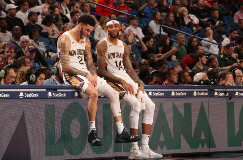 NEW ORLEANS, LA - DECEMBER 15: Lonzo Ball #2 of the New Orleans Pelicans and Brandon Ingram #14 of the New Orleans Pelicans smile during a game against the Orlando Magic on December 16, 2019 at the Smoothie King Center in New Orleans, Louisiana. NOTE TO USER: User expressly acknowledges and agrees that, by downloading and or using this Photograph, user is consenting to the terms and conditions of the Getty Images License Agreement. Mandatory Copyright Notice: Copyright 2019 NBAE (Photo by Layne Murdoch Jr./NBAE via Getty Images)