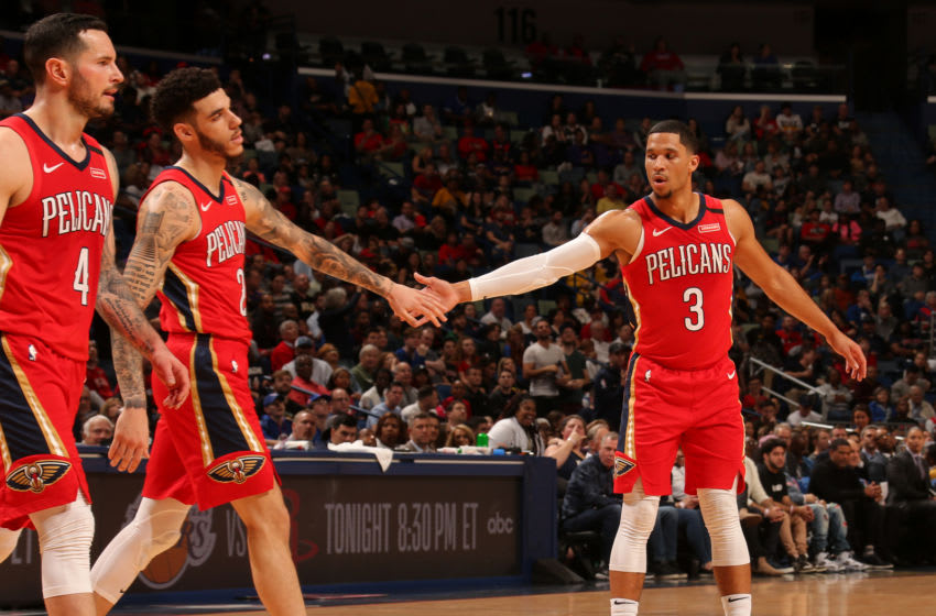 NEW ORLEANS, LA - JANUARY 18: Lonzo Ball #2, and Josh Hart #3 of the New Orleans Pelicans hi-five each other during the game against the LA Clippers on January 18, 2020 at the Smoothie King Center in New Orleans, Louisiana. NOTE TO USER: User expressly acknowledges and agrees that, by downloading and or using this Photograph, user is consenting to the terms and conditions of the Getty Images License Agreement. Mandatory Copyright Notice: Copyright 2020 NBAE (Photo by Layne Murdoch Jr./NBAE via Getty Images)