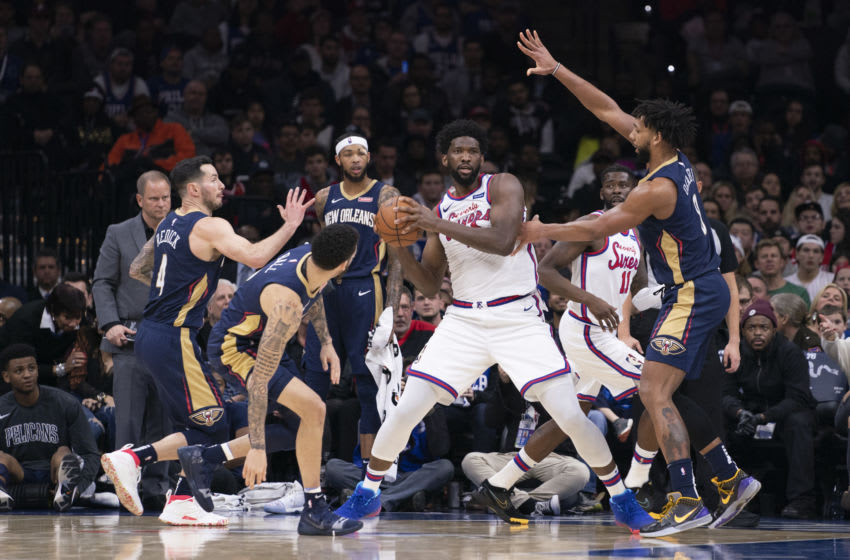 Joel Embiid #21 of the Philadelphia 76ers controls the ball against the New Orleans Pelicans (Photo by Mitchell Leff/Getty Images)