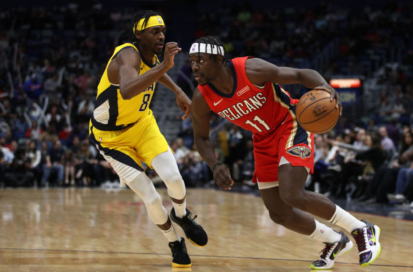NEW ORLEANS, LOUISIANA - DECEMBER 28: Jrue Holiday #11 of the New Orleans Pelicans drives the ball around Justin Holiday #8 of the Indiana Pacers (Photo by Chris Graythen/Getty Images)