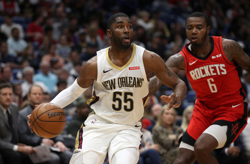 NEW ORLEANS, LOUISIANA - DECEMBER 29: E'Twaun Moore #55 of the New Orleans Pelicans drives the ball around Gary Clark #6 of the Houston Rockets at Smoothie King Center on December 29, 2019 in New Orleans, Louisiana. NOTE TO USER: User expressly acknowledges and agrees that, by downloading and/or using this photograph, user is consenting to the terms and conditions of the Getty Images License Agreement. (Photo by Chris Graythen/Getty Images)