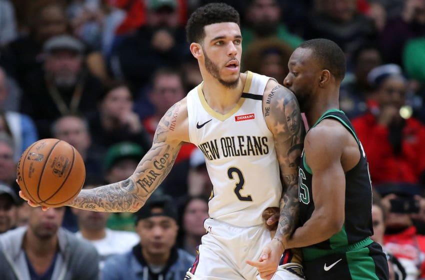 NEW ORLEANS, LOUISIANA - JANUARY 26: Lonzo Ball #2 of the New Orleans Pelicans drives against Kemba Walker #8 of the Boston Celtics during a game at the Smoothie King Center on January 26, 2020 in New Orleans, Louisiana. NOTE TO USER: User expressly acknowledges and agrees that, by downloading and or using this Photograph, user is consenting to the terms and conditions of the Getty Images License Agreement. (Photo by Jonathan Bachman/Getty Images)