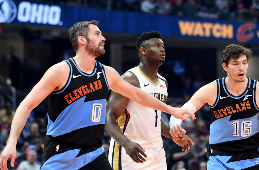 Kevin Love #0 an Cedi Osman #16 of the Cleveland Cavaliers box out Zion Williamson (Photo by Jason Miller/Getty Images)