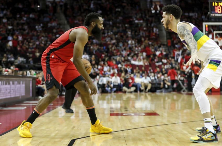 James Harden #13 of the Houston Rockets dribbles the ball defended by Lonzo Ball #2 of the New Orleans Pelicans(Photo by Tim Warner/Getty Images)