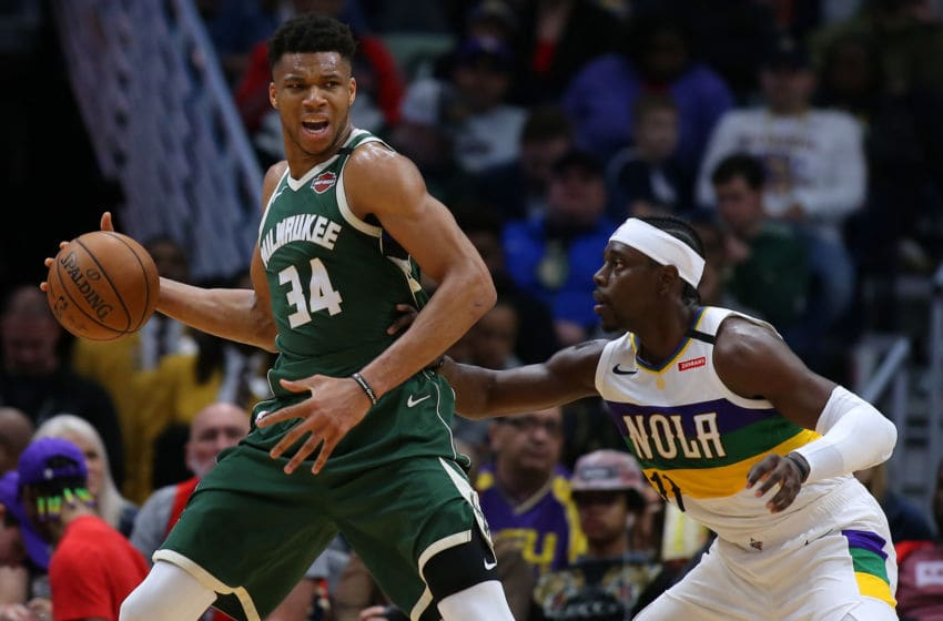 NEW ORLEANS, LOUISIANA - FEBRUARY 04: Giannis Antetokounmpo #34 of the Milwaukee Bucks drives against Jrue Holiday #11 of the New Orleans Pelicans (Photo by Jonathan Bachman/Getty Images)