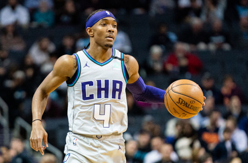 CHARLOTTE, NORTH CAROLINA - FEBRUARY 08: Devonte' Graham #4 of the Charlotte Hornets with the ball during the third quarter during their game against the Dallas Mavericks at Spectrum Center on February 08, 2020 in Charlotte, North Carolina. NOTE TO USER: User expressly acknowledges and agrees that, by downloading and/or using this photograph, user is consenting to the terms and conditions of the Getty Images License Agreement. (Photo by Jacob Kupferman/Getty Images)