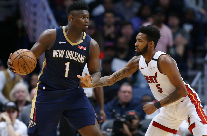 Zion Williamson #1 of the New Orleans Pelicans drives against Derrick Jones Jr. (Photo by Jonathan Bachman/Getty Images)