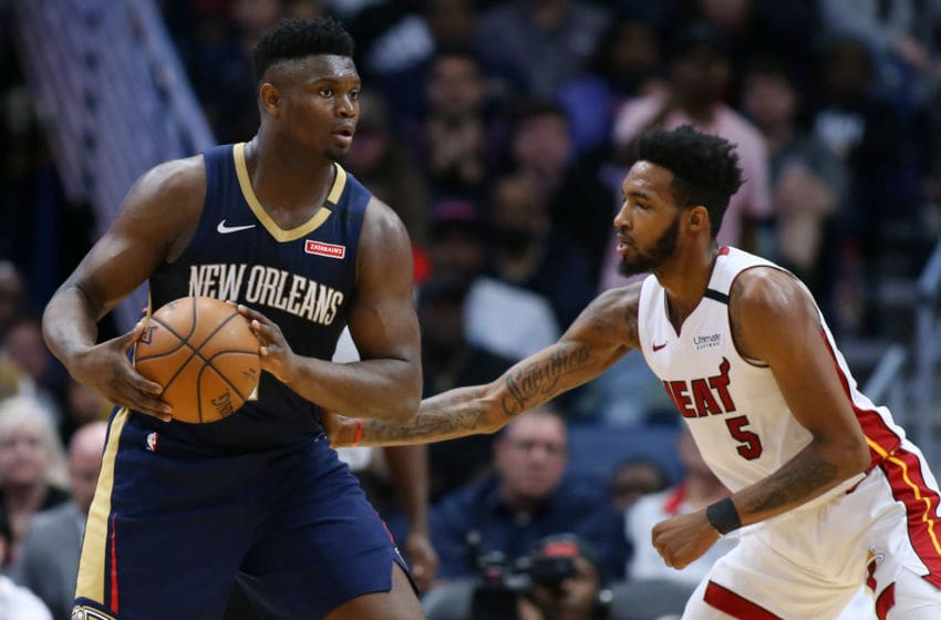 NEW ORLEANS, LOUISIANA - MARCH 06: Zion Williamson #1 of the New Orleans Pelicans drives against Derrick Jones Jr. . (Photo by Jonathan Bachman/Getty Images)