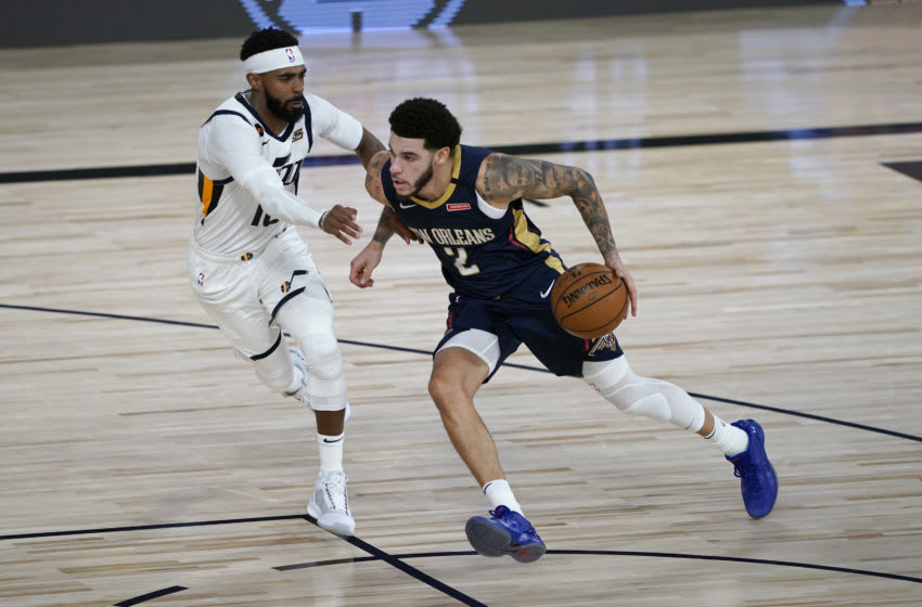 Lonzo Ball #2 of the New Orleans Pelicans drives against Mike Conley #10 of the Utah Jazz (Photo by Ashley Landis-Pool/Getty Images)