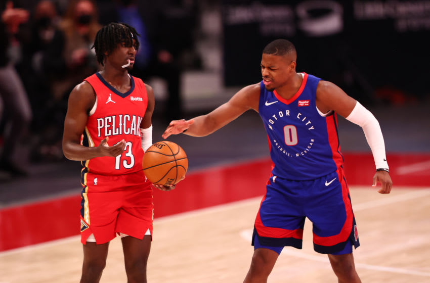 Dennis Smith Jr. #0 of the Detroit Pistons reacts as Kira Lewis Jr. #13 of the New Orleans Pelicans (Photo by Rey Del Rio/Getty Images)