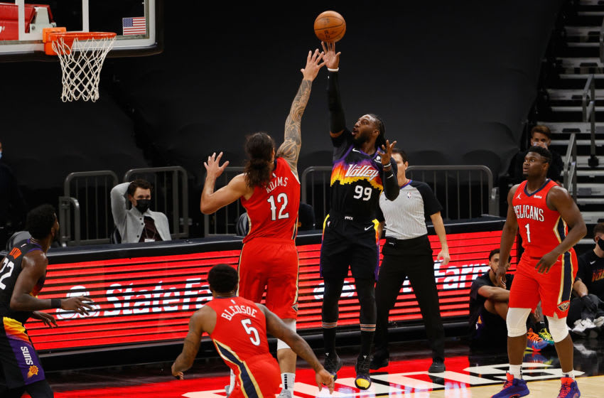 Jae Crowder #99 of the Phoenix Suns attempts a shot over Steven Adams #12 of the New Orleans Pelicans (Photo by Christian Petersen/Getty Images)