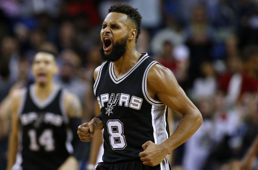Patty Mills #8 of the San Antonio Spurs reacts after scoring during overtime of a game against the New Orleans Pelicans (Photo by Jonathan Bachman/Getty Images)