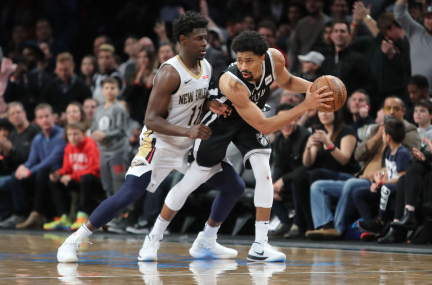 Spencer Dinwiddie #8 of the Brooklyn Nets works against Jrue Holiday #11 of the New Orleans Pelicans (Photo by Abbie Parr/Getty Images)