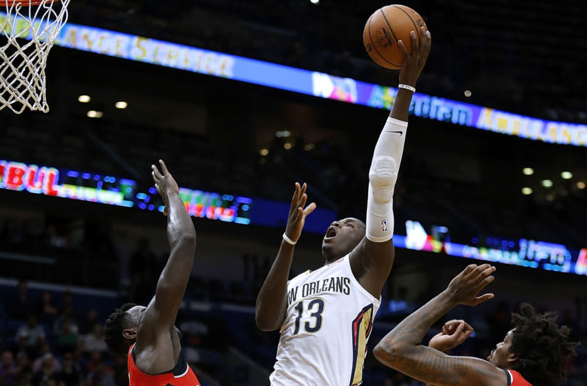 NEW ORLEANS, LA - NOVEMBER 15: Cheick Diallo #13 of the New Orleans Pelicans shoots over Lucas Nogueira #92 of the Toronto Raptors during the first half of a game at the Smoothie King Center on November 15, 2017 in New Orleans, Louisiana. NOTE TO USER: User expressly acknowledges and agrees that, by downloading and or using this Photograph, user is consenting to the terms and conditions of the Getty Images License Agreement. (Photo by Jonathan Bachman/Getty Images)