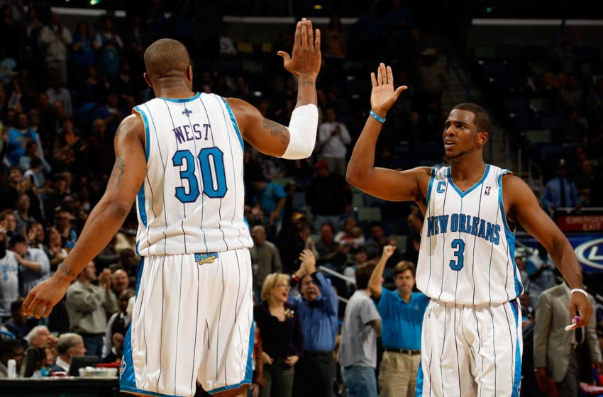 NEW ORLEANS - DECEMBER 16: Chris Paul #3 and David West #30 of the New Orleans Hornets celebrate during the game against the Detroit Pistons at New Orleans Arena on December 16, 2009 in New Orleans, Louisiana. The Hornets defeated the Pistons 95-87. NOTE TO USER: User expressly acknowledges and agrees that, by downloading and or using this Photograph, user is consenting to the terms and conditions of the Getty Images License Agreement. Mandatory Copyright Notice: (Photo by Chris Graythen/Getty Images)