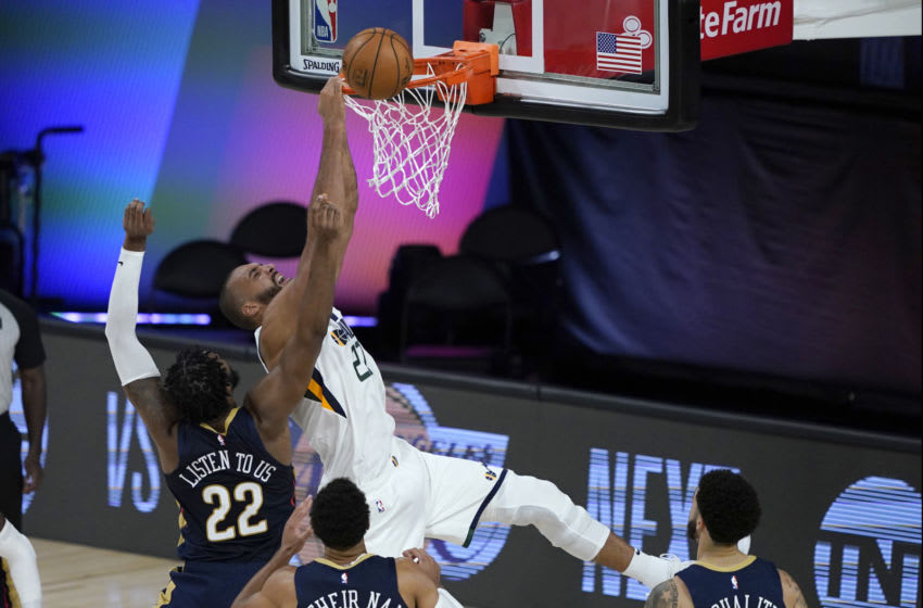 Derrick Favors of the New Orleans Pelicans tries to block Rudy Gobert (Photo by Ashley Landis-Pool/Getty Images)