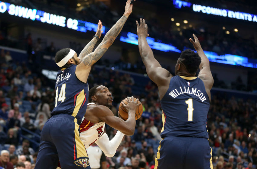 Mar 6, 2020; New Orleans, Louisiana, USA; Miami Heat forward Bam Adebayo (13) controls the ball against New Orleans Pelicans forwards Brandon Ingram (14) and Zion Williamson ( Chuck Cook-USA TODAY Sports