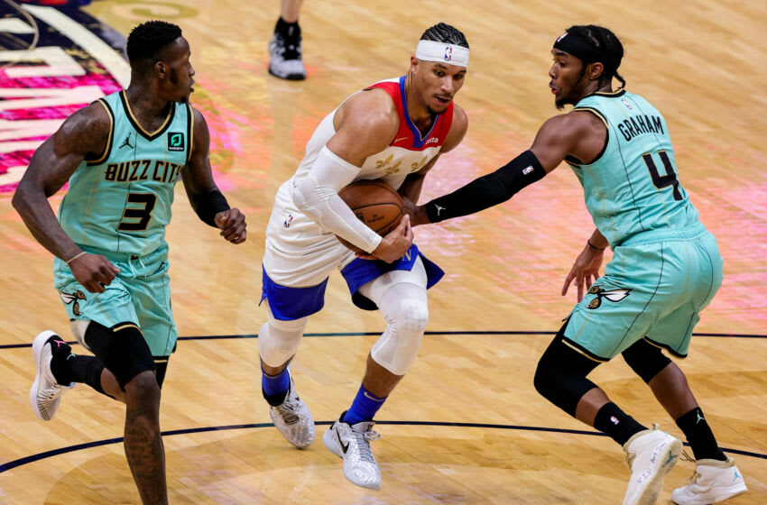 New Orleans Pelicans guard Josh Hart (3) is fouled by Charlotte Hornets guard Devonte' Graham Credit: Stephen Lew-USA TODAY Sports