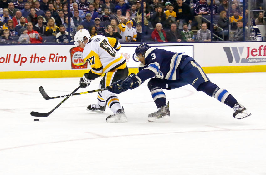 Seth Jones #3 of the Columbus Blue Jackets battles Sidney Crosby #87 of the Pittsburgh Penguins. (Photo by Kirk Irwin/Getty Images)