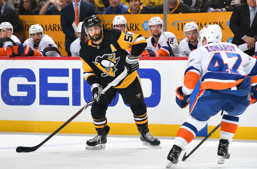PITTSBURGH, PA - APRIL 16: Kris Letang #58 of the Pittsburgh Penguins skates against the New York Islanders in Game Four of the Eastern Conference First Round during the 2019 NHL Stanley Cup Playoffs at PPG Paints Arena on April 16, 2019 in Pittsburgh, Pennsylvania. (Photo by Joe Sargent/NHLI via Getty Images)