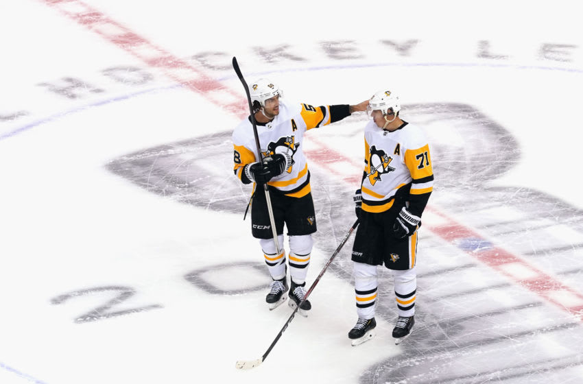 Kris Letang #58 and Evgeni Malkin #71 of the Pittsburgh Penguins. (Photo by Andre Ringuette/Freestyle Photo/Getty Images)