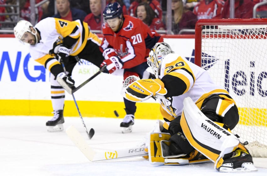 WASHINGTON, DC - APRIL 29: Pittsburgh Penguins defenseman Justin Schultz (4) defends a first period shot by Washington Capitals center Lars Eller (20) that is saved by goaltender Matt Murray (30) on April 29, 2018, at the Capital One Arena in Washington, D.C. in the Second Round of the Stanley Cup Playoffs. The Washington Capitals defeated the Pittsburgh Penguins, 4-1. (Photo by Mark Goldman/Icon Sportswire via Getty Images)