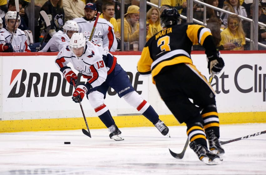 PITTSBURGH, PA - MAY 03: Jakub Vrana #13 of the Washington Capitals skates the puck up ice against Olli Maatta #3 of the Pittsburgh Penguins in Game Four of the Eastern Conference Second Round during the 2018 NHL Stanley Cup Playoffs at PPG PAINTS Arena on May 3, 2018 in Pittsburgh, Pennsylvania. Pittsburgh defeated Washington 3-1. (Photo by Kirk Irwin/Getty Images) *** Local Caption *** Jakub Vrana;Olli Maatta