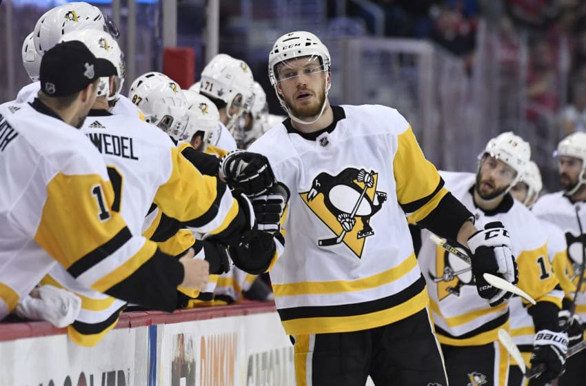 WASHINGTON, DC - MAY 05: Jamie Oleksiak #6 of the Pittsburgh Penguins celebrates after scoring a first period goal against the Washington Capitals in Game Five of the Eastern Conference Second Round during the 2018 NHL Stanley Cup Playoffs at Capital One Arena on May 5, 2018 in Washington, DC. (Photo by Patrick McDermott/NHLI via Getty Images)