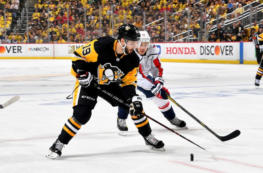 PITTSBURGH, PA - MAY 07: Derick Brassard #19 of the Pittsburgh Penguins handles the puck against T.J. Oshie #77 of the Washington Capitals in Game Six of the Eastern Conference Second Round during the 2018 NHL Stanley Cup Playoffs at PPG Paints Arena on May 7, 2018 in Pittsburgh, Pennsylvania. (Photo by Joe Sargent/NHLI via Getty Images)