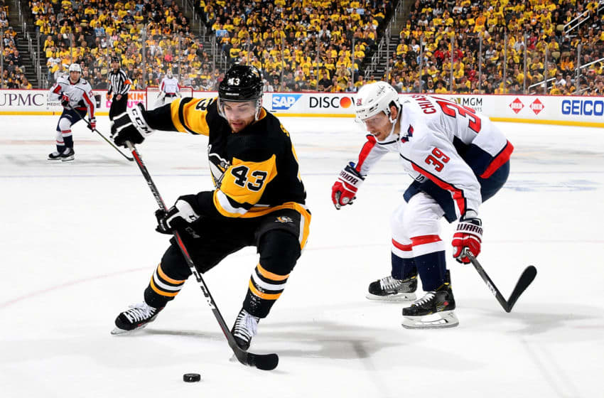 PITTSBURGH, PA - MAY 07: Conor Sheary #43 of the Pittsburgh Penguins handles the puck against Alex Chiasson #39 of the Washington Capitals in Game Six of the Eastern Conference Second Round during the 2018 NHL Stanley Cup Playoffs at PPG Paints Arena on May 7, 2018 in Pittsburgh, Pennsylvania. (Photo by Joe Sargent/NHLI via Getty Images)