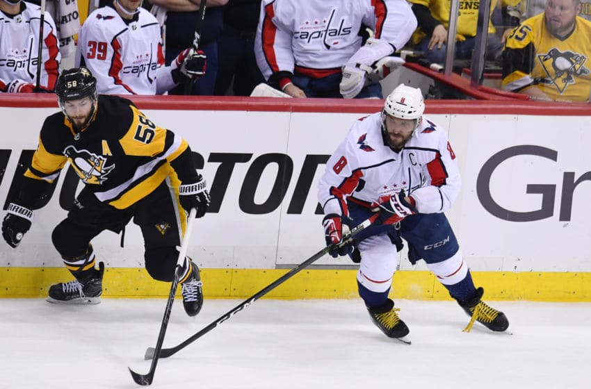 PITTSBURGH, PA - MAY 07: Pittsburgh Penguins defenseman Kris Letang (58) and Washington Capitals Left Wing Alex Ovechkin (8) go for the puck during the second period. The Washington Capitals went on win 2-1 in the overtime period against the Pittsburgh Penguins in Game Six of the Eastern Conference Second Round during the 2018 NHL Stanley Cup Playoffs on May 7, 2018, at PPG Paints Arena in Pittsburgh, PA. The Capitals won the series 4-2 and advance to the Eastern Conference Final. (Photo by Jeanine Leech/Icon Sportswire via Getty Images)