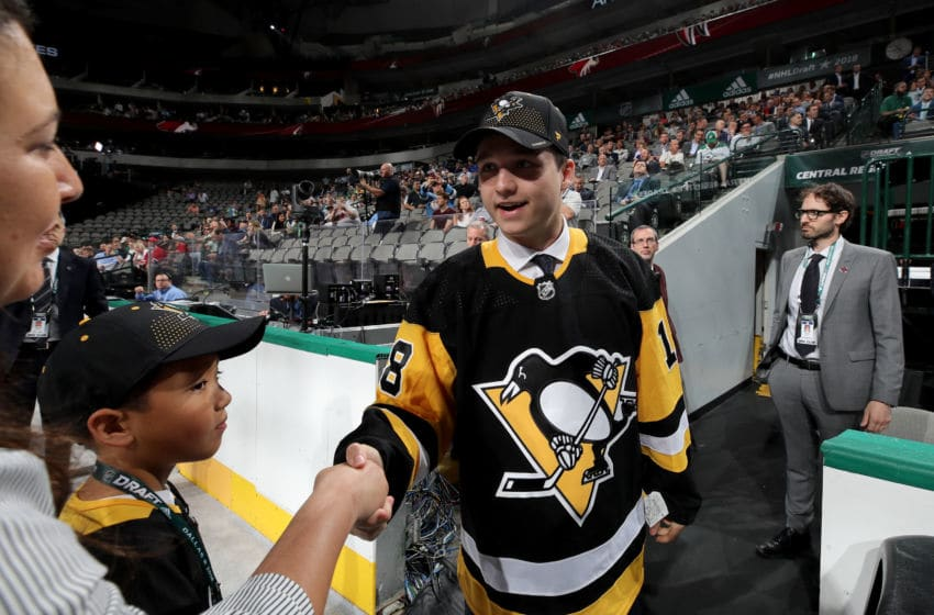 DALLAS, TX - JUNE 23: Calen Addison reacts after being selected 53rd overall by the Pittsburgh Penguins during the 2018 NHL Draft at American Airlines Center on June 23, 2018 in Dallas, Texas. (Photo by Bruce Bennett/Getty Images)