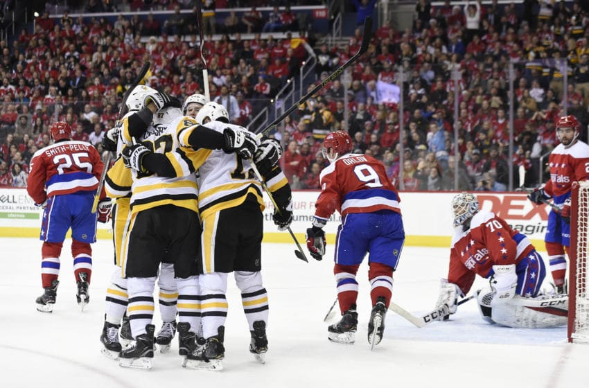 WASHINGTON, DC - DECEMBER 19: Bryan Rust #17 of the Pittsburgh Penguins celebrates with his teammates after scoring a goal in the second period against the Washington Capitals at Capital One Arena on December 19, 2018 in Washington, DC. (Photo by Patrick McDermott/NHLI via Getty Images)