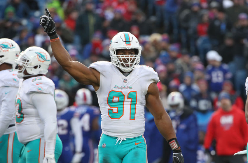 BUFFALO, NY - DECEMBER 30: Cameron Wake #91 of the Miami Dolphins motions during NFL game action against the Buffalo Bills at New Era Field on December 30, 2018 in Buffalo, New York. (Photo by Tom Szczerbowski/Getty Images)