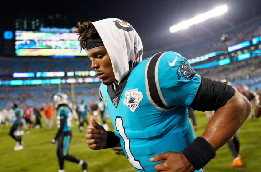 CHARLOTTE, NORTH CAROLINA - SEPTEMBER 12: Cam Newton #1 of the Carolina Panthers runs off the field after their game against the Tampa Bay Buccaneers at Bank of America Stadium on September 12, 2019 in Charlotte, North Carolina. (Photo by Jacob Kupferman/Getty Images)