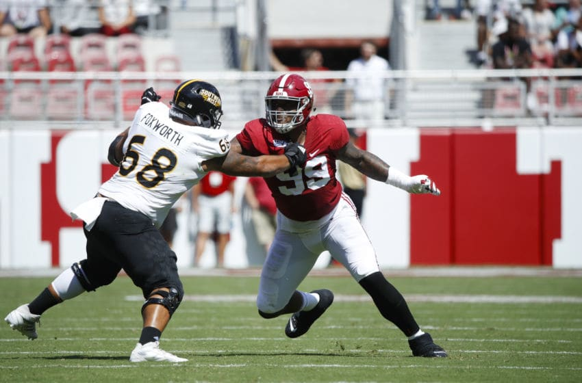 TUSCALOOSA, AL - SEPTEMBER 21: Raekwon Davis #99 of the Alabama Crimson Tide in action on defense during a game against the Southern Mississippi Golden Eagles at Bryant-Denny Stadium on September 21, 2019 in Tuscaloosa, Alabama. Alabama defeated Southern Miss 49-7. (Photo by Joe Robbins/Getty Images)