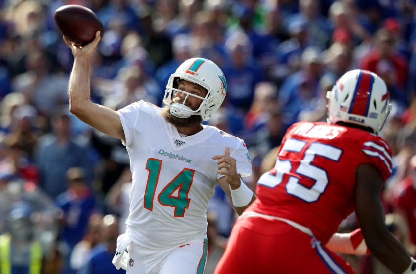 ORCHARD, NEW YORK - OCTOBER 20: Ryan Fitzpatrick #14 of the Miami Dolphins throws the ball during the second quarter of an NFL game against the Buffalo Bills at New Era Field on October 20, 2019 in Orchard Park, New York. (Photo by Bryan M. Bennett/Getty Images)
