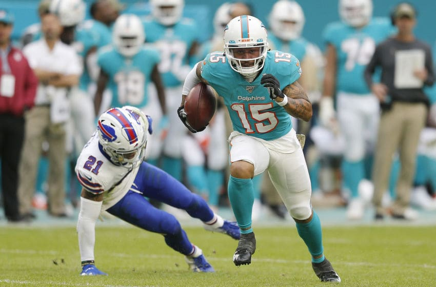 MIAMI, FLORIDA - NOVEMBER 17: Albert Wilson #15 of the Miami Dolphins breaks a tackle from Jordan Poyer #21 of the Buffalo Bills during the fourth quarter at Hard Rock Stadium on November 17, 2019 in Miami, Florida. (Photo by Michael Reaves/Getty Images)