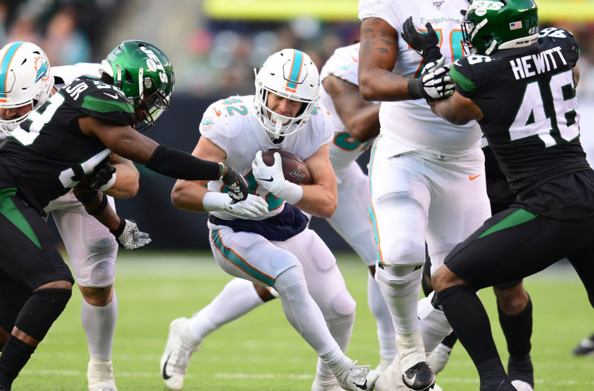 EAST RUTHERFORD, NEW JERSEY - DECEMBER 08: Patrick Laird #42 of the Miami Dolphins carries the ball during the second half of their game against the New York Jets at MetLife Stadium on December 08, 2019 in East Rutherford, New Jersey. (Photo by Emilee Chinn/Getty Images)