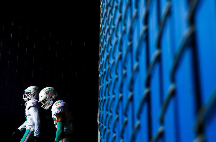 FOXBOROUGH, MA - DECEMBER 29: The Miami Dolphins walk through the tunnel towards the field before a game against the New England Patriots at Gillette Stadium on December 29, 2019 in Foxborough, Massachusetts. (Photo by Adam Glanzman/Getty Images)