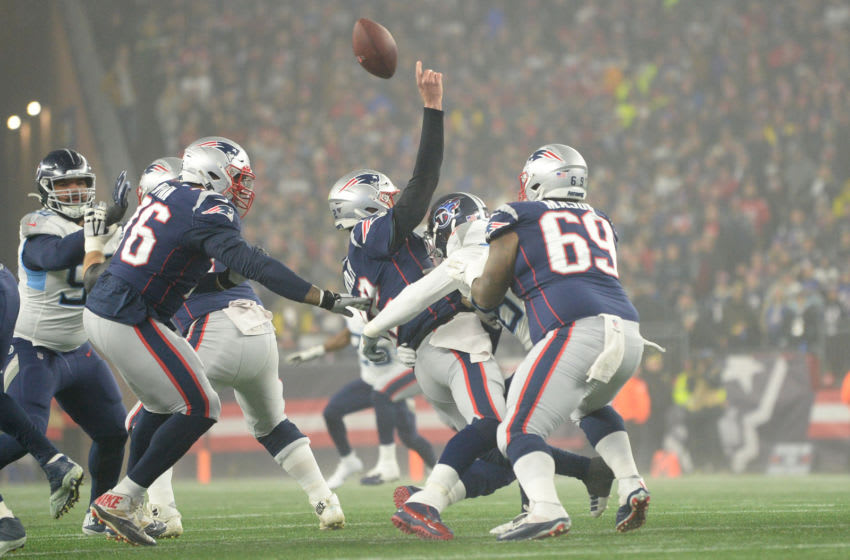 FOXBOROUGH, MASSACHUSETTS - JANUARY 04: Tom Brady #12 of the New England Patriots is hit as they take on the Tennessee Titans in the first half of the AFC Wild Card Playoff game at Gillette Stadium on January 04, 2020 in Foxborough, Massachusetts. (Photo by Kathryn Riley/Getty Images)