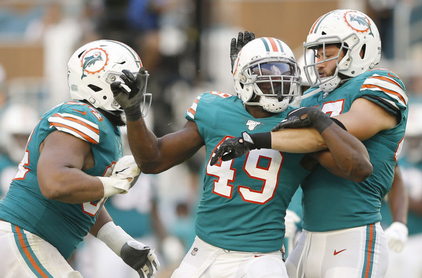 MIAMI, FLORIDA - DECEMBER 01: Sam Eguavoen #49 of the Miami Dolphins reacts after a sack against the Philadelphia Eagles during the fourth quarter at Hard Rock Stadium on December 01, 2019 in Miami, Florida. (Photo by Michael Reaves/Getty Images)